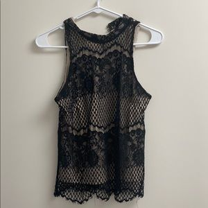 Fancy black and tan tank top with floral pattern